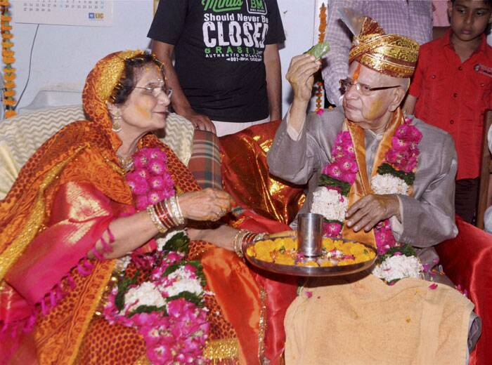 N D Tiwari marries mother of his biological son