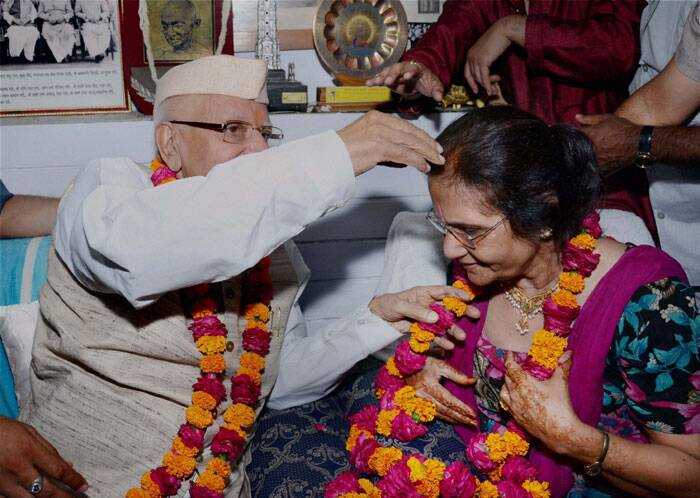 N D Tiwari, the former Chief Minister of Uttar Pradesh, was involved in a lengthy legal battle with Sharma, a retired teacher, to accept Shekhar as his biological son. <br /> Veteran Congress leader and former Andhra Pradesh Governor N D Tiwari (89) and Ujjwala Sharma at his residence in Lucknow on Thursday, a day after they got married. (Source: Photo by PTI)