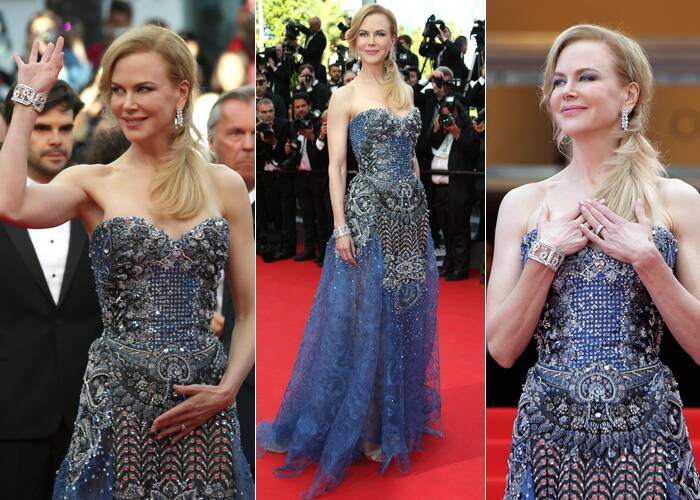 Nicole Kidman looked amazing in a bejeweled strapless gown by Armani and Harry Winston jewels. <br /><br /> The actress waves to the crowd as she arrives for the 67th Cannes Film Festival and the screening of the 'Grace of Monaco'. (Source: AP)