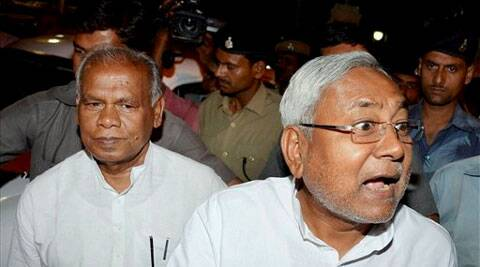 Former Bihar CM Nitish Kumar with Chief Minister-designate Jitanram Manjhi at the CM residence in Patna on Monday. (Source: PTI )