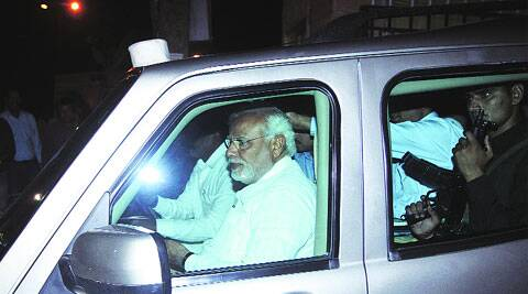 Modi leaves the RSS office after meeting RSS chief Mohan Bhagwat in New Delhi, Saturday. (Premnath Pandey)