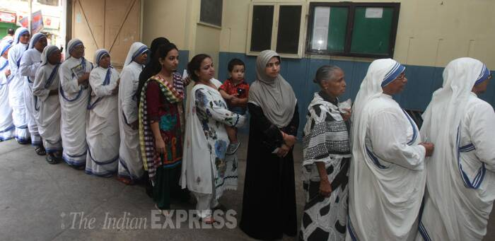 Nuns of Missionaries of Charity along with other queue up outside a polling booth in north Kolkata to exercise their franchise. ( Source: Express photo by Partha Paul )