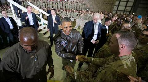 President Barack Obama shakes hands at a troop rally at Bagram Air Field, north of Kabul, Afghanistan, during an unannounced visit, on Sunday. (Source: AP)