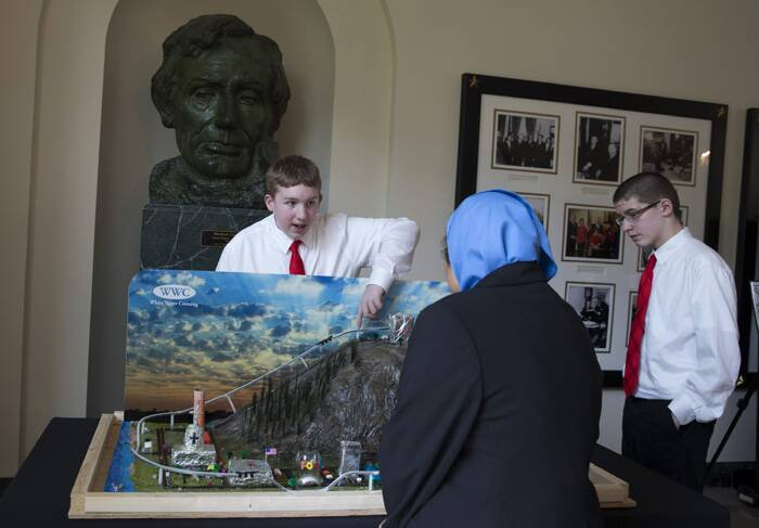 Josh Troutman and Tanner Schantz, of Bismark, N.D., demostrate the working of their vision of a future city at the Science Fair. (Source: AP)