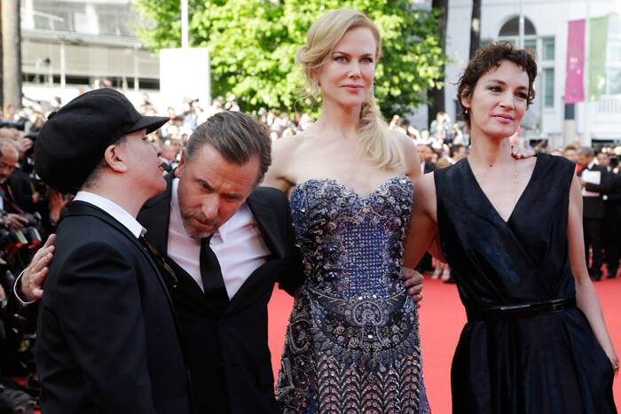 The cast of 'Grace of Monaco', Tim Roth, Nicole Kidman and Jeanne Balibar along with their director Olivier Dahan gear up for the screening of their film at the 67th Cannes Film Festival. (Source: AP)