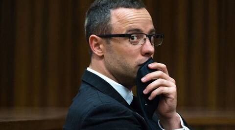 Oscar Pistorius, gestures, as he listens to psychiatric evidence for his defense, during his ongoing murder trial in Pretoria. (Source: AP)