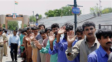 Border Security Force handing over Pakistani prisoners to Pak Rangers at Attari-Wagah land border on Friday. India had released 37 Pak prisoners including 32 fishermen to Pakistan as a good will gesture. (Source: PTI)
