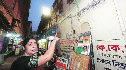 Sumita Banerjee, great-granddaughter of Haridas Pal, shows a plaque in his memory near their ancestral house in Kolkata. (Subham Dutta)