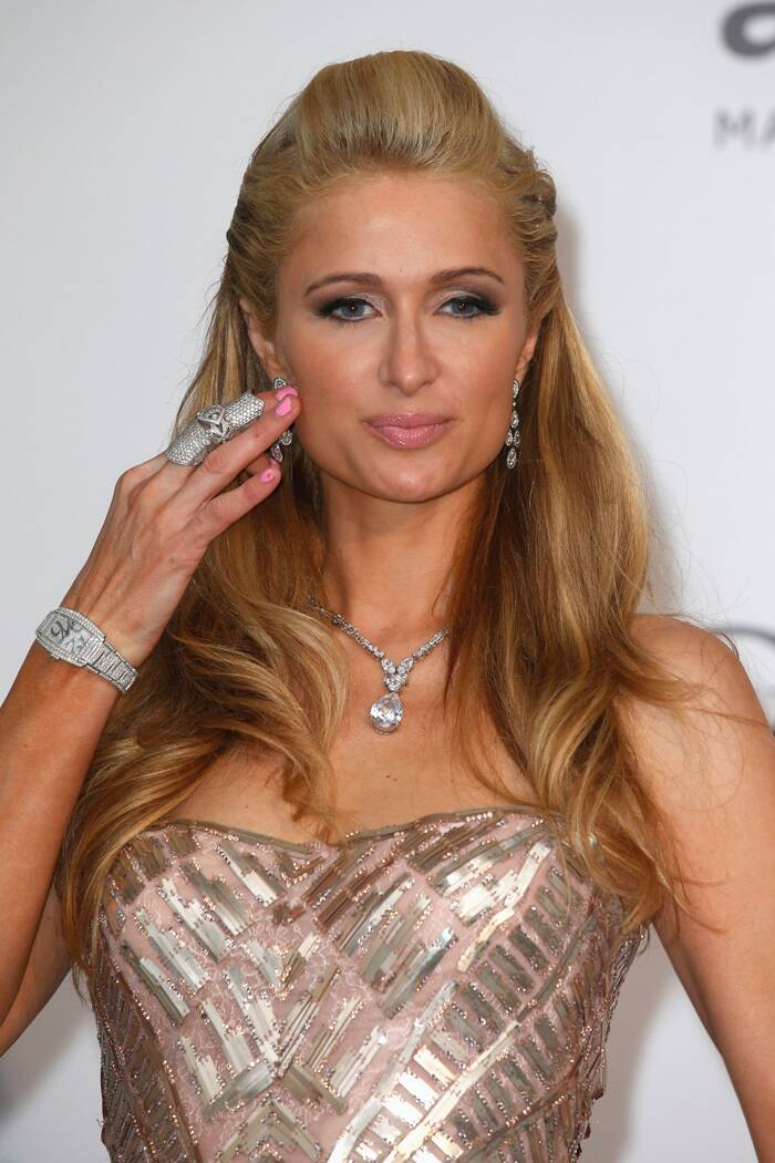 Hotel heiress Paris Hilton stepped out in a glamourous pink and silver gown with eye-catching diamond jewellery. (Source: Reuters)