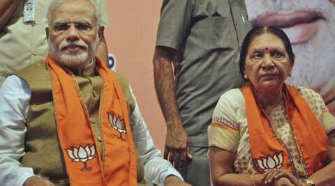 India's next prime minister Narendra Modi, left, sits with Anandiben Patel during a legislative meeting in Gandhinagar, India. (AP)