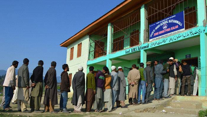 People in a long queue to cast their votes during the 8th phase of Lok Sabha elections,at Katianwali in District Baramulla 65 km's from Srinagar on Wednesday. PTI