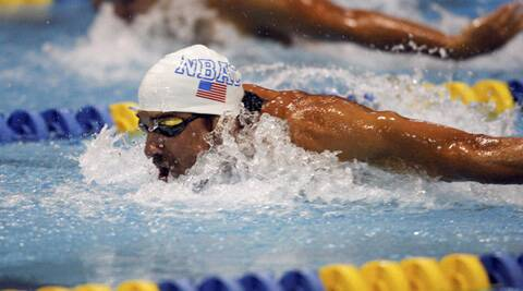 Michael Phelps wins the 100-meter butterfly at the Arena Grand Prix swim meet in Charlotte on Friday. (AP)