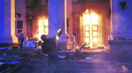 A protester throws a petrol bomb at the trade union building in Odessa Friday night. (Reuters)