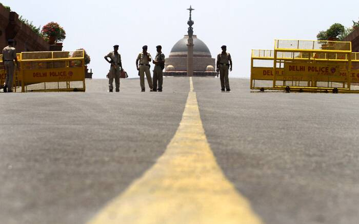 Policemen manning check posts on the eve of Narendra Modi's swearing-in ceremony. (IE photo by Ravi Kanojia)