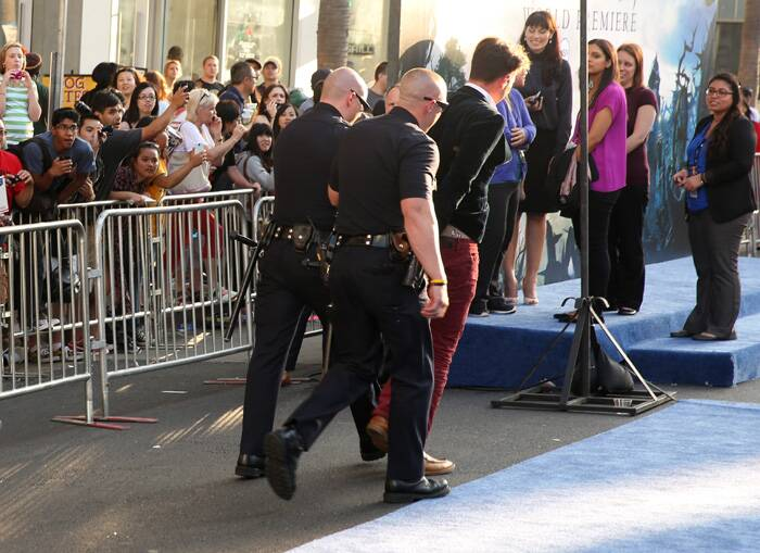 Jolie's fiance Brad Pitt was attacked by an unknown man at the premiere. <br /><br /> The man was led away in handcuffs after allegedly attacking Brad Pitt on the red carpet. (Source: AP)