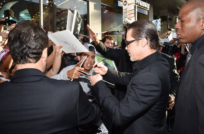 Brad Pitt was unhurt and soon resumed signing autographs. (Source: AP)
