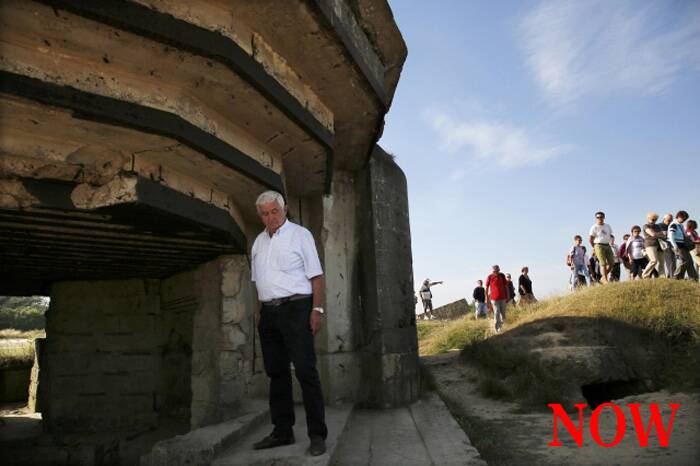 An Italian tourist views a bunker at a strategic site overlooking the D-Day beaches which had been captured by U.S. Army Rangers at Pointe du Hoc, France, August 22, 2013. (Source: Reuters)