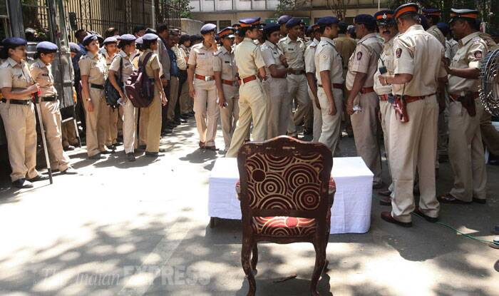 Security personnel are seen guarding at Elphinstone College in Mumbai.  (Source: Express Photo by Pradeep Kochrekar)