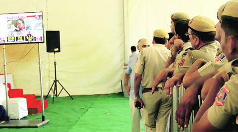 Security personnel watch the trends at a counting centre in the capital on Friday.  ( Source: Express photo by Prem Nath Pandey )