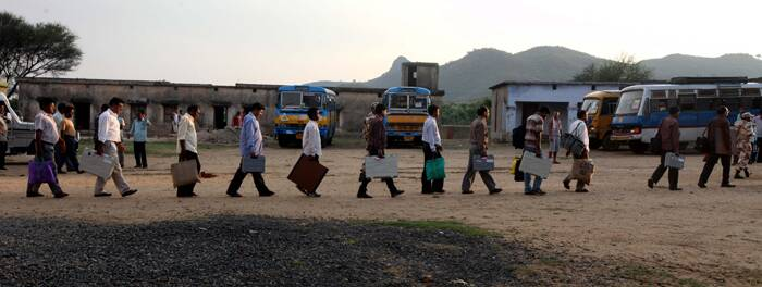 Polling personnel arrive at  higher secondary school in the Mudali village, West Bengal.  (Express photo by Partha Paul)