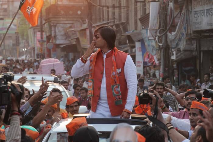 Vivek Oberoi blows kisses to BJP supporters in Varanasi. (Express photo by Anand Singh)