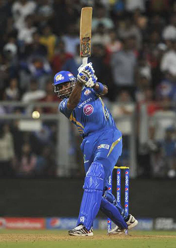 Mumbai Indians batsman Kieron Pollard plays a shot against Kings XI Punjab in Mumbai on Saturday. Pollard kept his nerves and played a sensational innings which contributed significantly in Mumbai Indians' first win of the tournament. (IE Photo Prashant Nadkar)