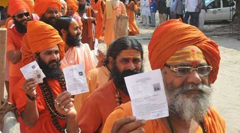 Sadhus show inked fingers after casting their votes for Lok Sabha elections, in Haridwar on Wednesday. (PTI Photo)