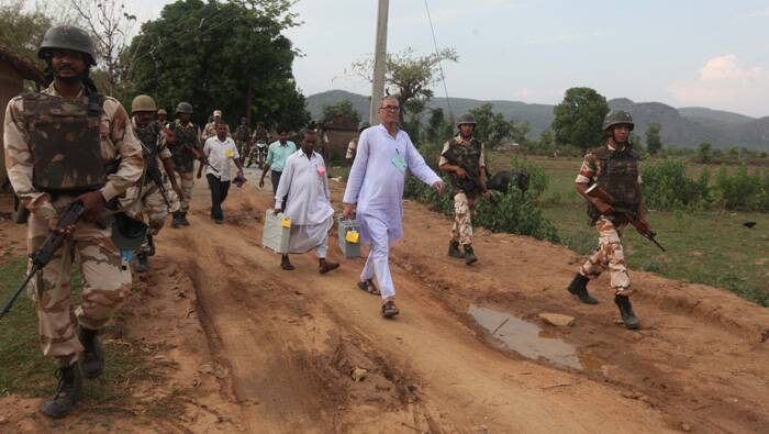 For the polling personnel it was an arduous task and it took six-kilometre trek on foot guarded by paramilitary forces. (Express photo by Partha Paul).