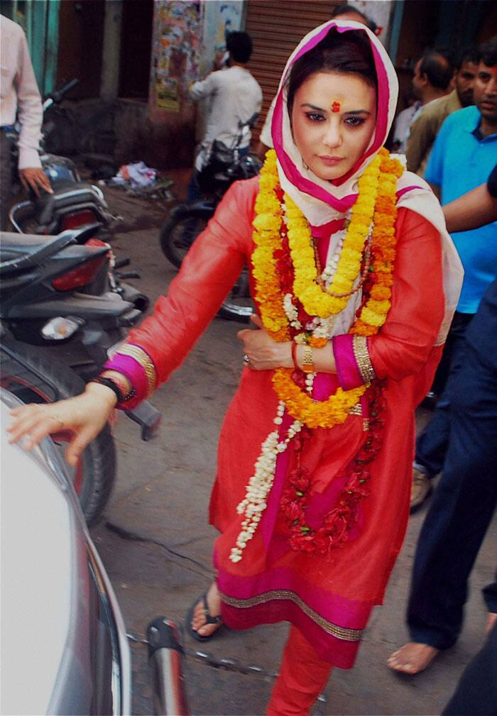 "Preity Zinta was pretty in a red churridar suit with a dupatta over her head and garlands around her neck. She tweeted: ""Good morning world ! This morning is definitely a holy one 4 me since I saw the sunrise over the Holy Ganga in the ancient city of Benaras."" (PTI)"