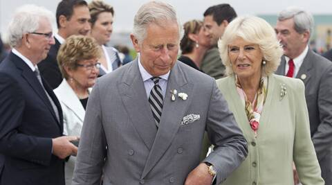 Prince Charles and Camilla, the Duchess of Cornwall, head to their aircraft as they prepare to leave Charlottetown, Prince Edward Island, Canada, on Tuesday, May 20, 2014. Prince Charles and Camilla are on a four-day tour of Canada.  (AP Photo/The Canadian Press, Andrew Vaughan)