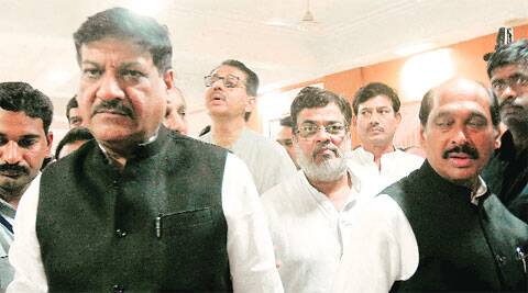 Mahasrashtra Congress chief Manikrao Thackeray with CM Prithviraj Chavan at an MPCC assessment meeting in Parel, Mumbai, on Monday.Express photo: Pradeep Kochrekar