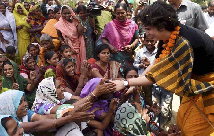 Priyanka Vadra meets villagers during an election campaign for her brother and Congress Vice President Rahul Gandhi in Amethi on Friday. (PTI)