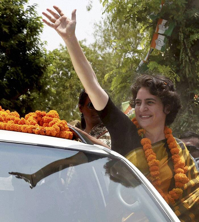 Priyanka Vadra waves during her election campaign for her brother and Congress Vice President Rahul Gandhi in Amethi on Friday. (PTI)