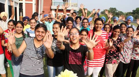 Jubilant students who got their class 10 CBSE results at Guru Nanak Public School in Ludhiana. (Express Photo by Gurmeet Singh)