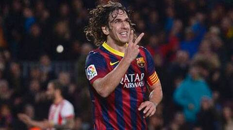 Puyol made his debut under former coach Louis van Gaal and helped the club win Champions League titles in 2006, 2009 and 2011 (AP)