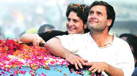 Rahul Gandhi with sister Priyanka Vadra at a roadshow at Jais, Amethi, on Sunday. (PTI)