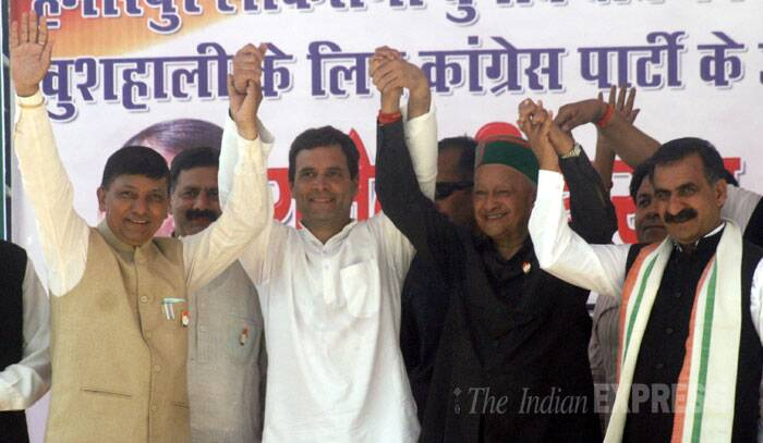 Congress Vice President Rahul Gandhi (centre), Himachal Pradesh CM Virbhadra Singh and others wave to their supporters in Bilaspur. (IE Photo: Lalit Kumar)