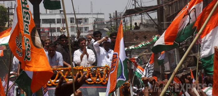 The 43-year-old leader flanked by Congress candidate Ajay Rai began his roadshow in a Muslim-dominated Gol Gadda area, waving to supporters who surrounded his vehicle. (IE Photo: Neeraj Priyadarshi)