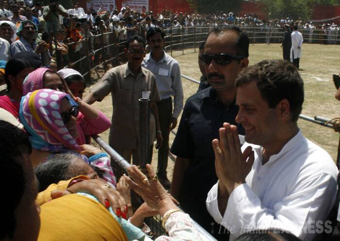Rahul Gandhi meets a supporter during his election rally in Bilaspur. (IE Photo: Lalit Kumar)
