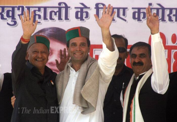 Congress Vice President Rahul Gandhi with Himachal Pradesh Chief Minister Virbhadra Singh and State President Sukhwinder Singh wave during an election rally in Bilaspur on Thursday. (IE Photo: Lalit Kumar)