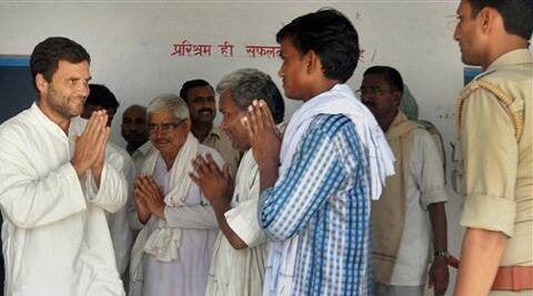 Rahul Gandhi greets voters outside a polling station in Amethi, in the northern Indian state of Uttar Pradesh. (AP)