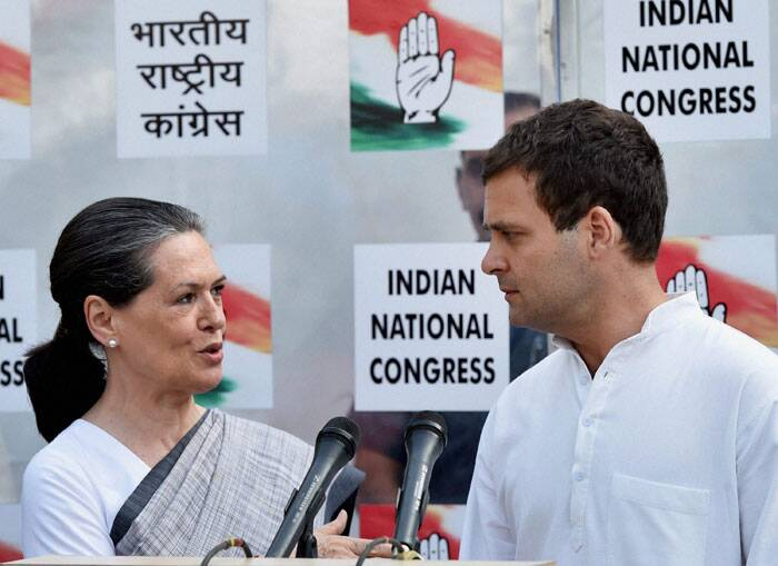 Congress President Sonia Gandhi with party Vice President Rahul Gandhi at a press conference in New Delhi on Friday. (PTI)