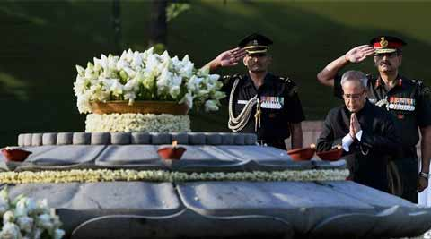 President Pranab Mukherjee pays tributes to former Prime Minister Rajiv Gandhi on his 23rd death anniversary at 'Vir Bhumi' in New Delhi on Wednesday. (AP Photo)