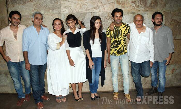 Alia Bhatt, whose last release '2 States' recently entered the Rs 100 crore club was seen spending some family time with mom Soni Razdan and dad Mahesh Bhatt. The trio were seen at the screening of Rajkummar Rao's next release 'CityLights', which has been produced by Mahesh Bhatt. <br /><br />Seen here Alia, Soni and Mahesh pose with Patralekhaa, Rajkummar, Hansal Mehta. (Source: Varinder Chawla)