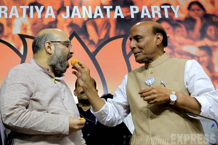 BJP President Rajnath Singh gave the credit for the party's performance in Lok Sabha polls to Narendra Modi, saying he has the capability to lead the country. <br /><br /> Seen here Rajnath Singh congratulating Amit Shah. (Source: Express Photo by Ravi Kanojia)