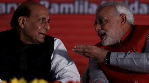 A day after Narendra Modi's long meeting with top RSS brass, BJP president Rajnath Singh on Sunday met senior Sangh leaders at the RSS office. (Express Photo)