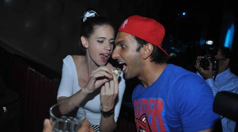 Kalki was snapped jokingly feeding mouthfuls to Ranveer who sat with his mouth wide open.