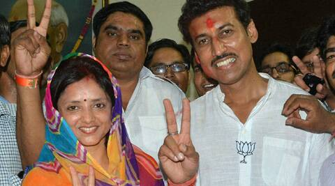 Rathore with his wife after winning from Jaipur Rural. (PTI)