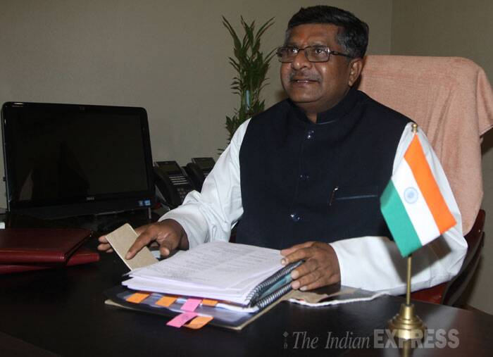 Ravi Shankar Prasad signs a paper as the Communications and Information Technology; Law and Justice minister at the Sanchar Bhawan  in New Delhi on Tuesday. (Source: Express photo by Prem Nath Pandey)