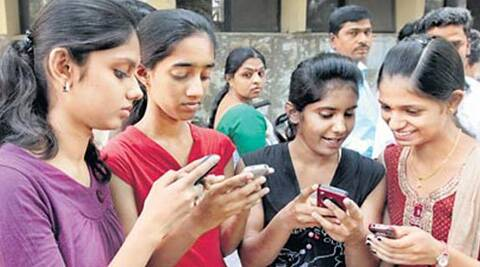 Girls checking Class 12th results on Saturday. ( Source: PTI )